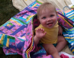 The youngest great-granddaughter receiving her Gigi quilt